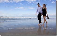 depositphotos_6470066-romantic-man-and-woman-couple-walking-on-a-beach